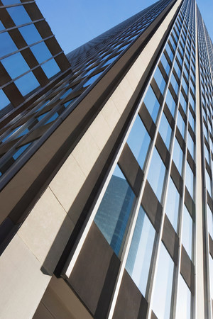 tallness: Low angle view of office building