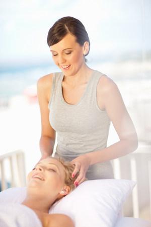Woman giving scalp massage outdoors