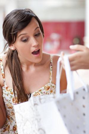 disbelief: Woman looking in shopping bag
