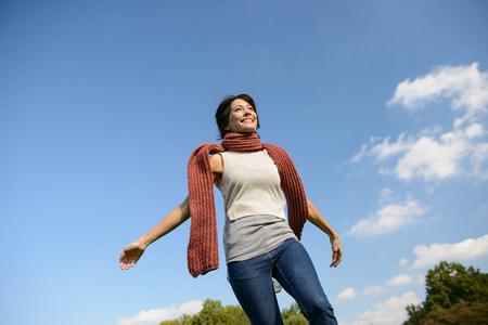 low self esteem: Smiling woman walking outdoors