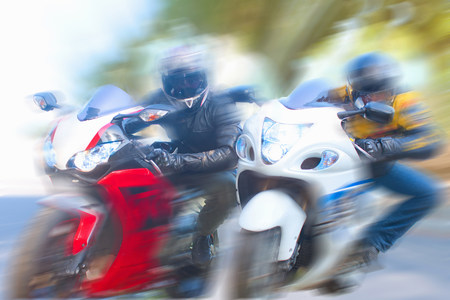 Blurred view of men riding motorcycles