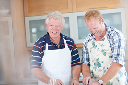 Father and son cooking in kitchen LANG_EVOIMAGES