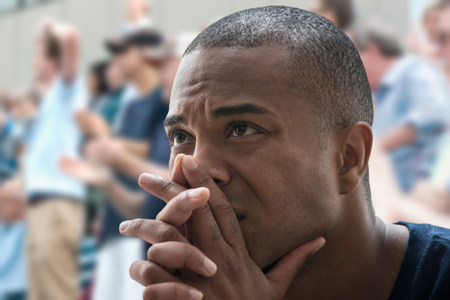 off shoulder: Tense man at sports game
