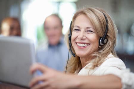Older woman wearing headset