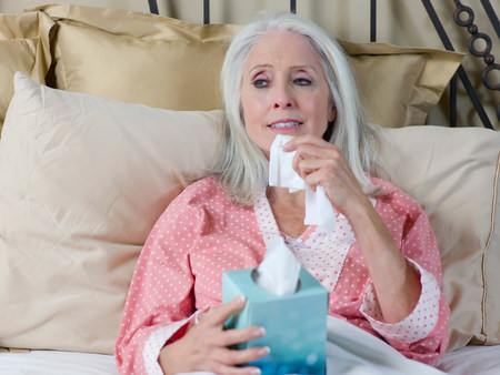 recuperating: Sick older woman laying in bed