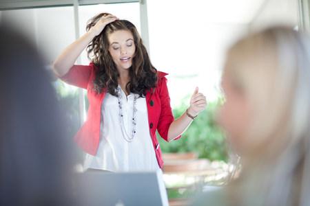 Businesswoman talking in meeting LANG_EVOIMAGES