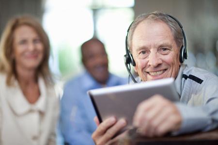 hands free phone: Older man wearing headset LANG_EVOIMAGES