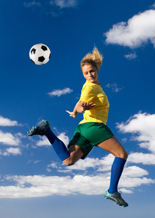 Soccer player kicking in mid-air LANG_EVOIMAGES