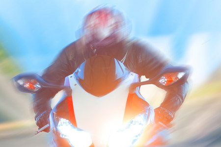 perilous: Blurred view of man riding motorcycle