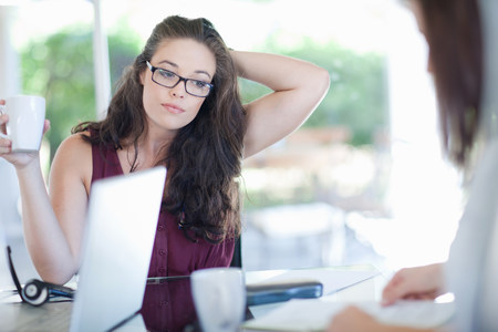 Businesswoman sitting in meeting LANG_EVOIMAGES