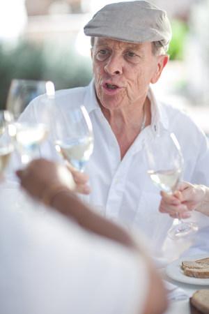 berets: Older friends having wine together