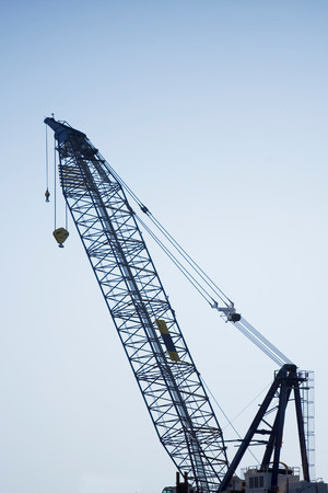 housebuilding: Silhouette of crane against sky LANG_EVOIMAGES