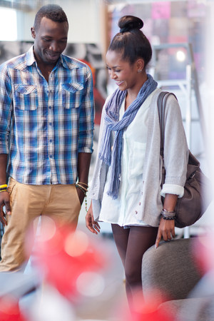 commodities: Couple shopping together in store LANG_EVOIMAGES