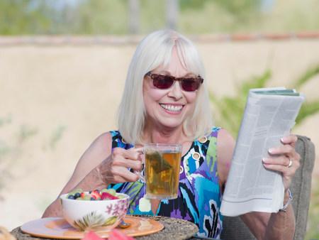 tea breaks: Older woman having breakfast outdoors