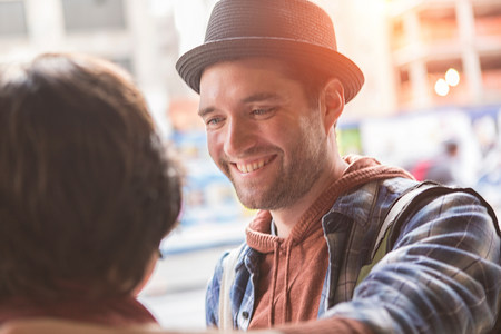 Man smiling at girlfriend outdoors