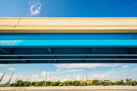Freeway overpass in suburban landscape