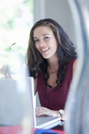 Woman smiling at laptop