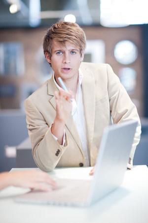 Businessman talking at desk
