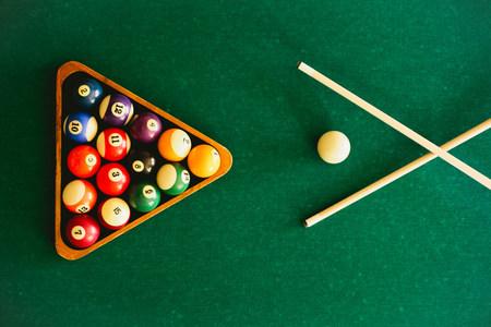pool cues: Balls arranged on pool table
