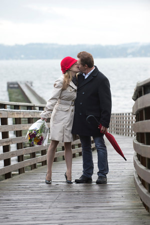 smooch: Couple kissing on wooden dock