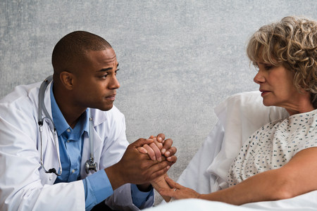 recuperating: Doctor holding patients hand