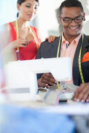 Dressmakers working in studio