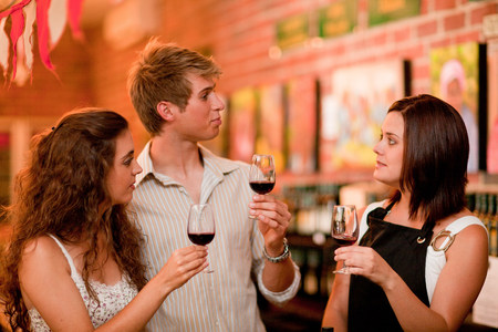 Server and customers tasting wine