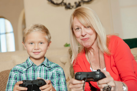 off shoulder: Mother and son playing video games