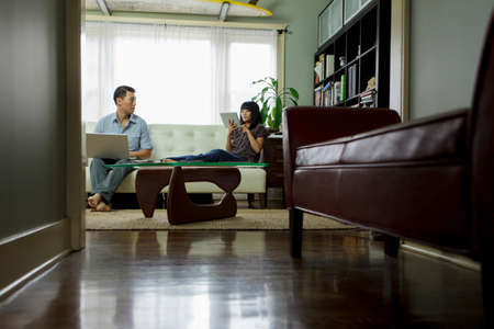electronic organiser: Couple relaxing in living room