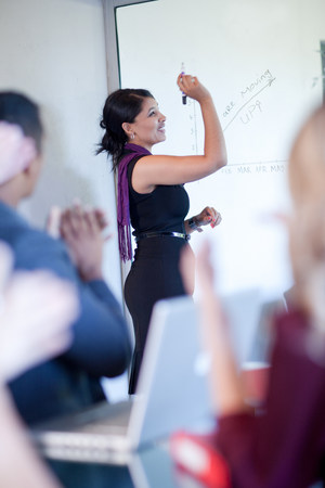 Businesswoman making graph on glass