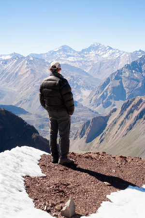 astonishing: Hiker overlooking snowy mountains LANG_EVOIMAGES