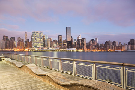 seating area: New York City skyline lit up at dusk