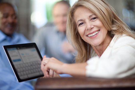 Older woman using tablet computer