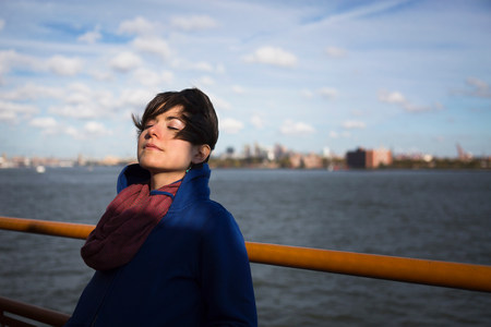 ponderous: Woman on ferry in urban harbor LANG_EVOIMAGES