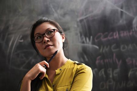 engrossed: Portrait of woman in front of blackboard