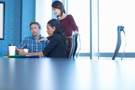 Business people working at desk LANG_EVOIMAGES