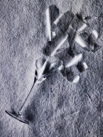 endings: Broken wine glass on stone floor