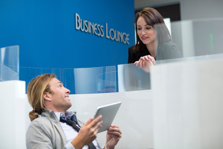 partitions: Business people talking in lounge LANG_EVOIMAGES