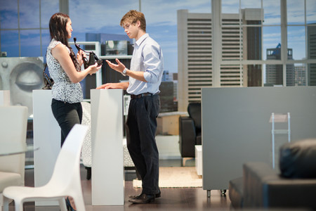 Woman shopping with salesman in store