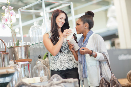 decide deciding: Woman shopping with saleswoman in store