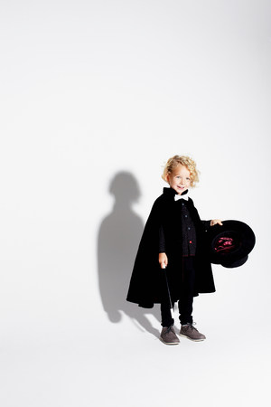 conjuring: Boy wearing magician costume LANG_EVOIMAGES
