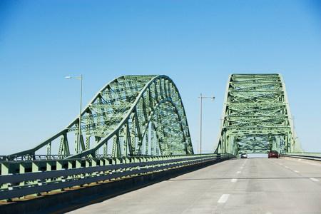 tallness: Cars driving on bridge