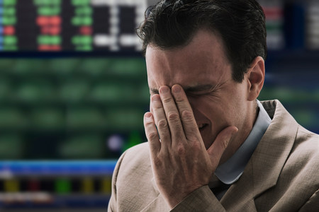 jobless: Businessman crying at stock exchange