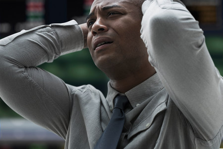 disillusioned: Stressed businessman at stock exchange