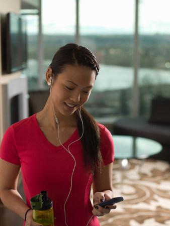 keeping room: Woman listening to earphones