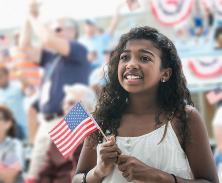 Girl holding american flag,looking anxious
