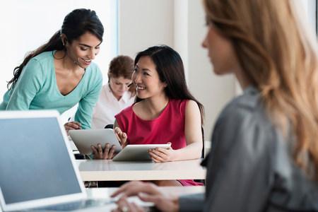 handsfree telephones: Businesswomen talking in office