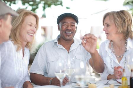Older friends having wine together