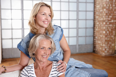 age 25 30 years: Mother and daughter relaxing on sofa