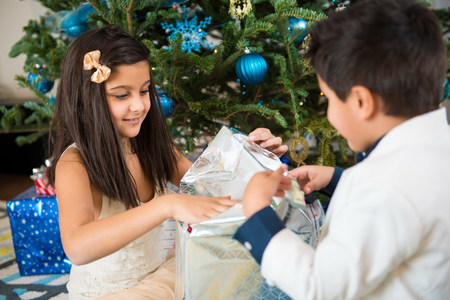 Children opening Christmas present